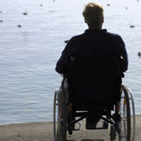 Man in wheelchair near a body of water